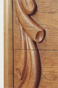 Carved cherry dresser drawer detail