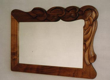 Carved walnut mirror