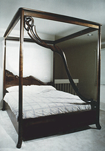 carved walnut canopy bed