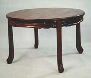 carved walnut round table